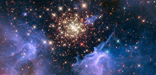 A dense cluster of hot stars with whisps of gas around it.